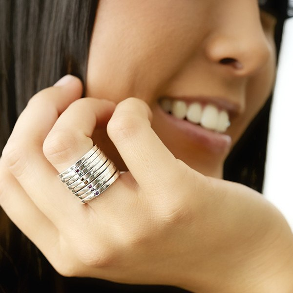 Silver birthstoone stacking rings on model