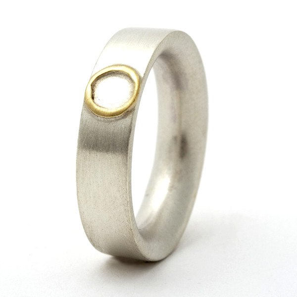Sterling silver ring with 18ct gold circle detail