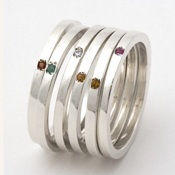 collection of silver birthstone stacking rings