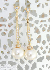 Gold cream pearl earrings