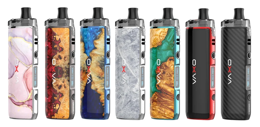 Several colorful Origin X pod kits displayed in a row.