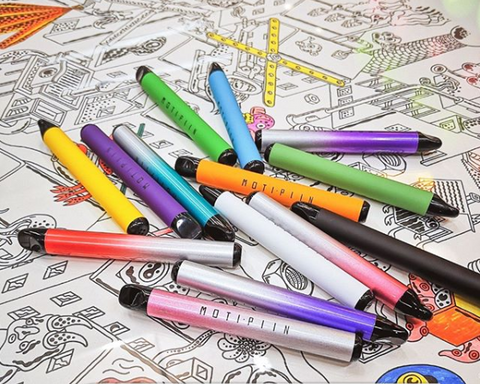 A pile of colorful vape pens scattered across a black and white drawing.