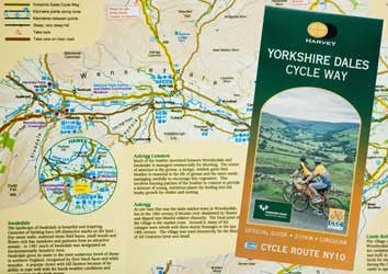 Image shows front cover and sample map page of Yorkshire Dales Cycle Way map guide
