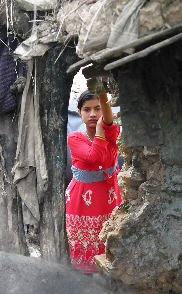 Nepalese girl seen through window by chance
