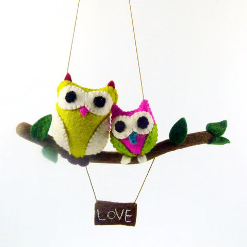 Swinging Owl on a branch, Pink