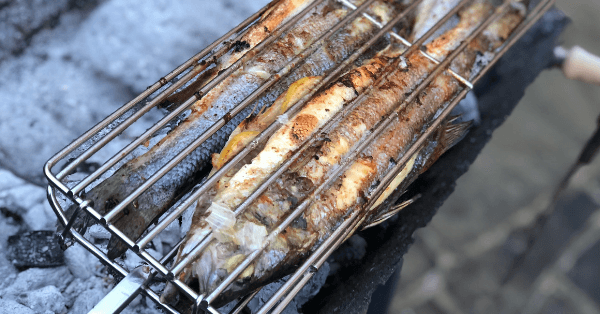 Whole Sea Bass cooked over charcoal on a Cyprus BBQ