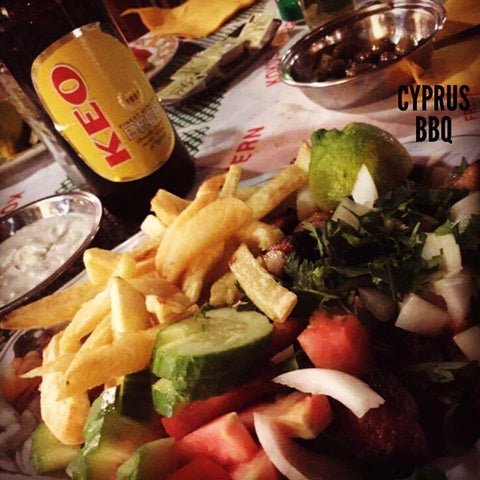 Keo Beer and a Souvlaki Kebab with Chips and Salad