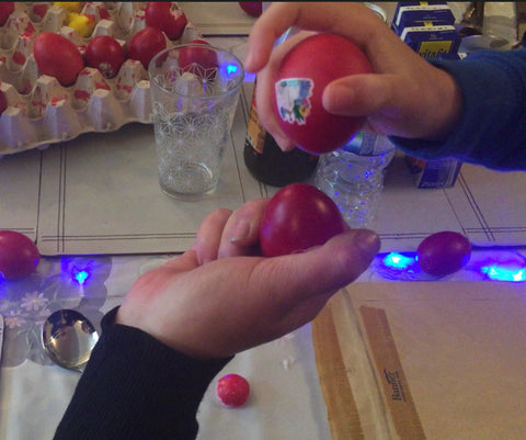 Traditional Greek Orthodox Red Eggs - cracking the egg