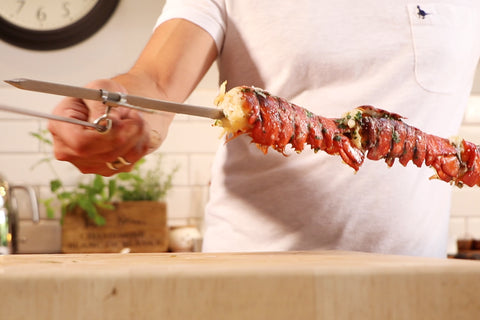 Lobster Tails Cooked on a Souvla Skewer over coals on a Cyprus BBQ