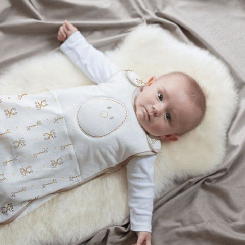 baby in giraffe sleep sack