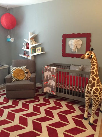 red safari nursery with april the giraffe