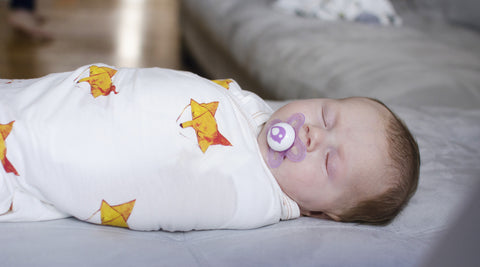 baby sleeping in swaddle blanket