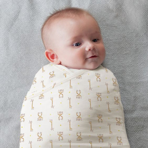 starry safari zen swaddle with giraffes