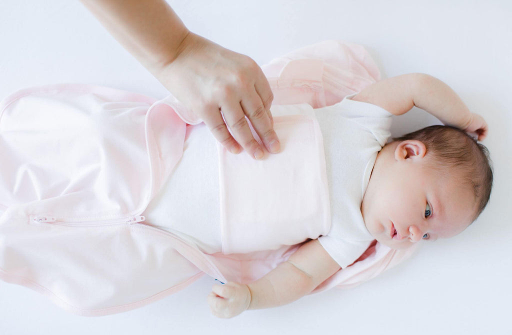 Swaddle with arms out using secure inner band