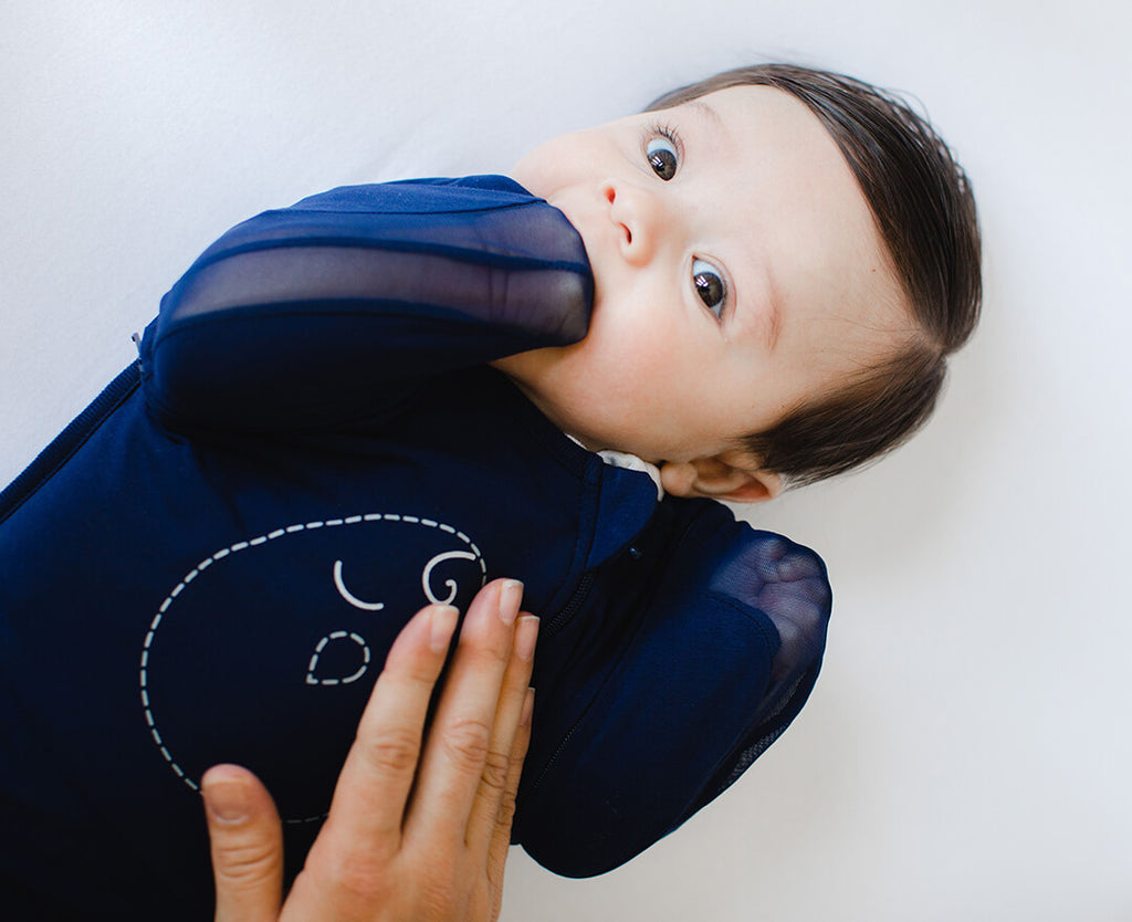 Swaddle with arms out using breathable mesh sleeves