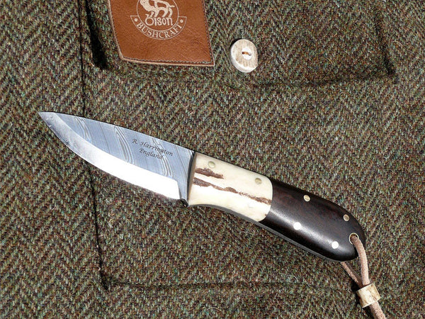 Bushmans Pal with Twist Pattern Damasteel Blade, Walnut Scales and Antler Bolsters