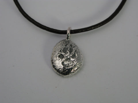 Silver trackers pendant