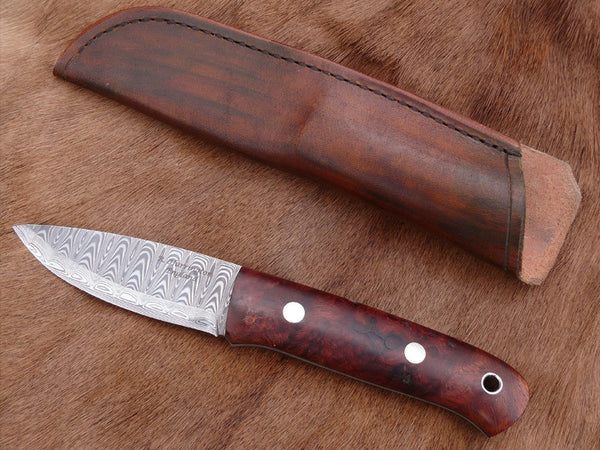 Damasteel and Amboyona Burl