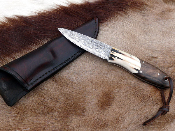 Bushcraft Knife in Hakapella Damasteel Walnut scales and Antler Bolsters