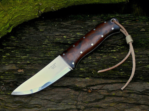Hunter RWL34 and Desert Ironwood Scales over Black Fibre Liners. Stainless fittings.