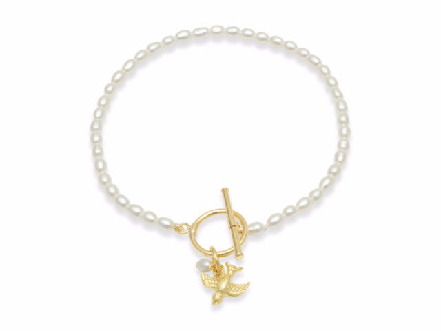 Vita cultured freshwater oval pearl bracelet with a gold-plated swallow charm