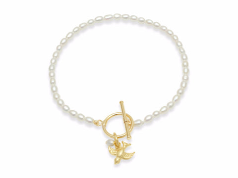 Cultured freshwater oval pearl bracelet with a gold-plated swallow charm
