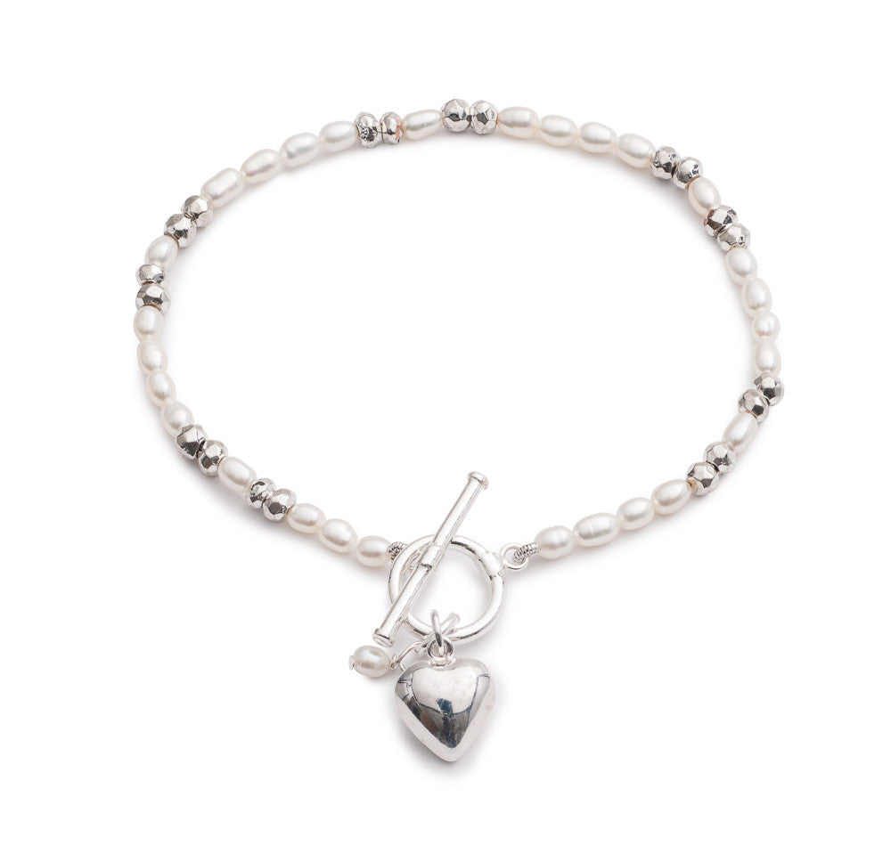 White cultured freshwater pearl bracelet with a silver heart charm