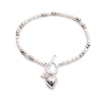 Amare white cultured freshwater pearl bracelet with a silver heart charm