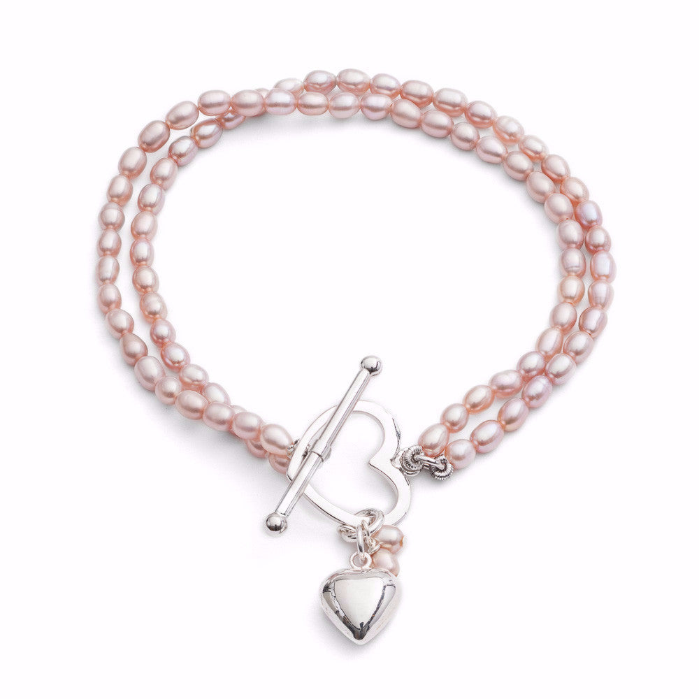 Double strand pink oval cultured freshwater pearl bracelet with silver heart charm