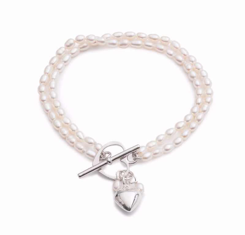 Double strand white oval cultured freshwater pearl bracelet with silver heart charm