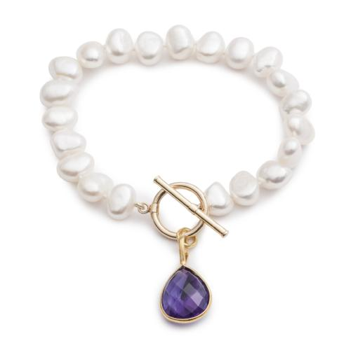 Clara white irregular cultured freshwater pearl bracelet with an amethyst drop pendant
