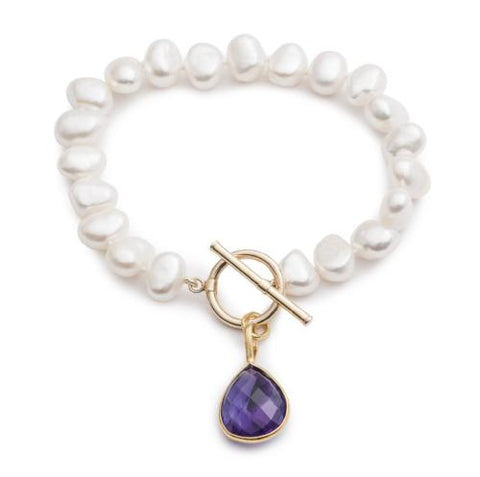 White irregular cultured freshwater pearl bracelet with an amethyst drop pendant