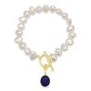 White irregular cultured freshwater pearl bracelet with a lapis lazuli drop pendant
