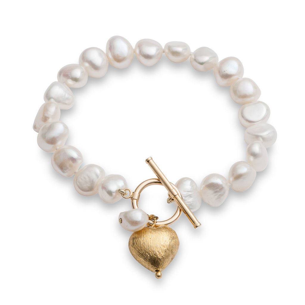 White irregular cultured freshwater pearl bracelet with a gold heart
