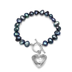 Black irregular cultured freshwater pearl bracelet with a silver hammered heart pendant