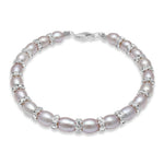 Pink oval cultured freshwater pearl and silver bracelet