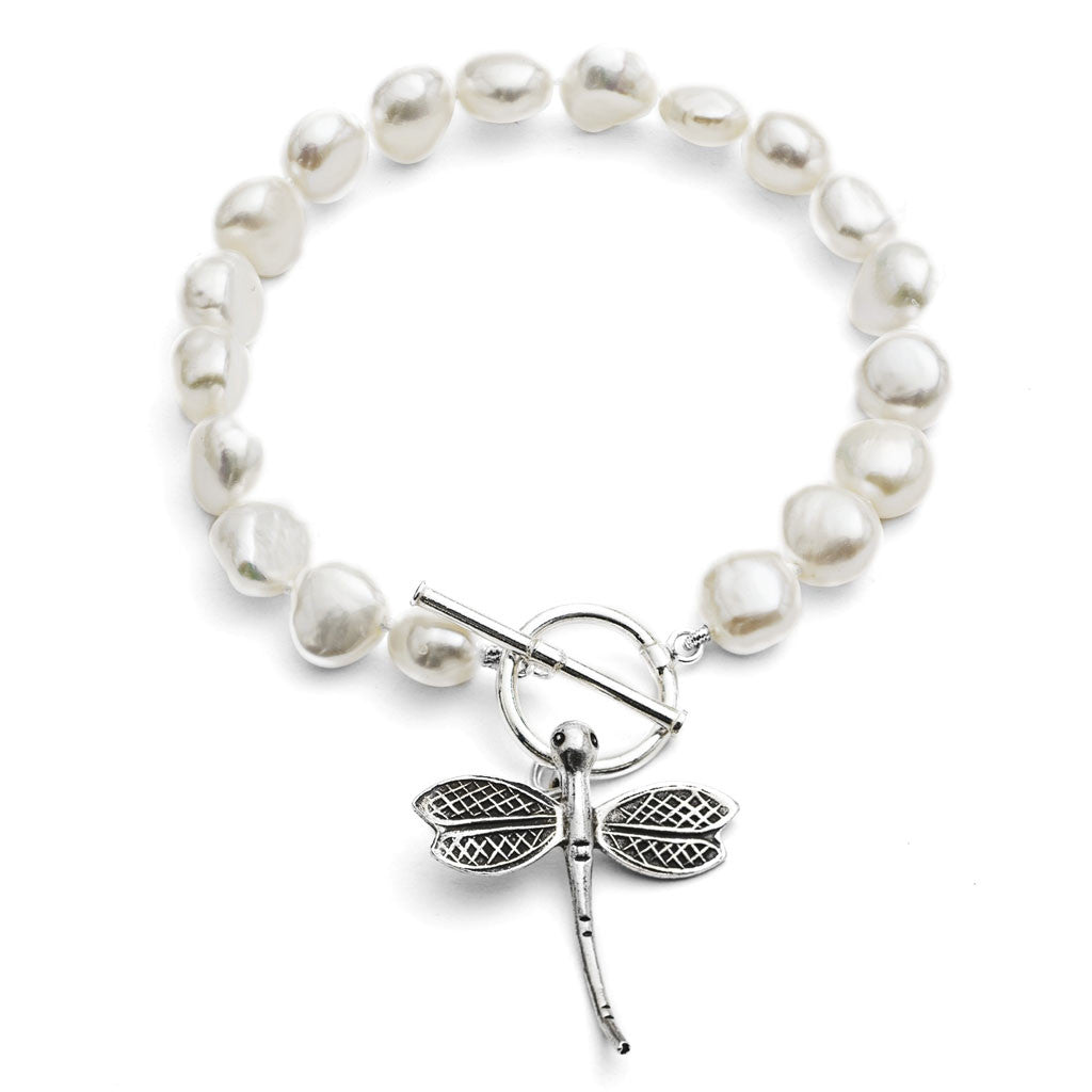 White cultured freshwater pearl bracelet with a sterling silver dragonfly charm