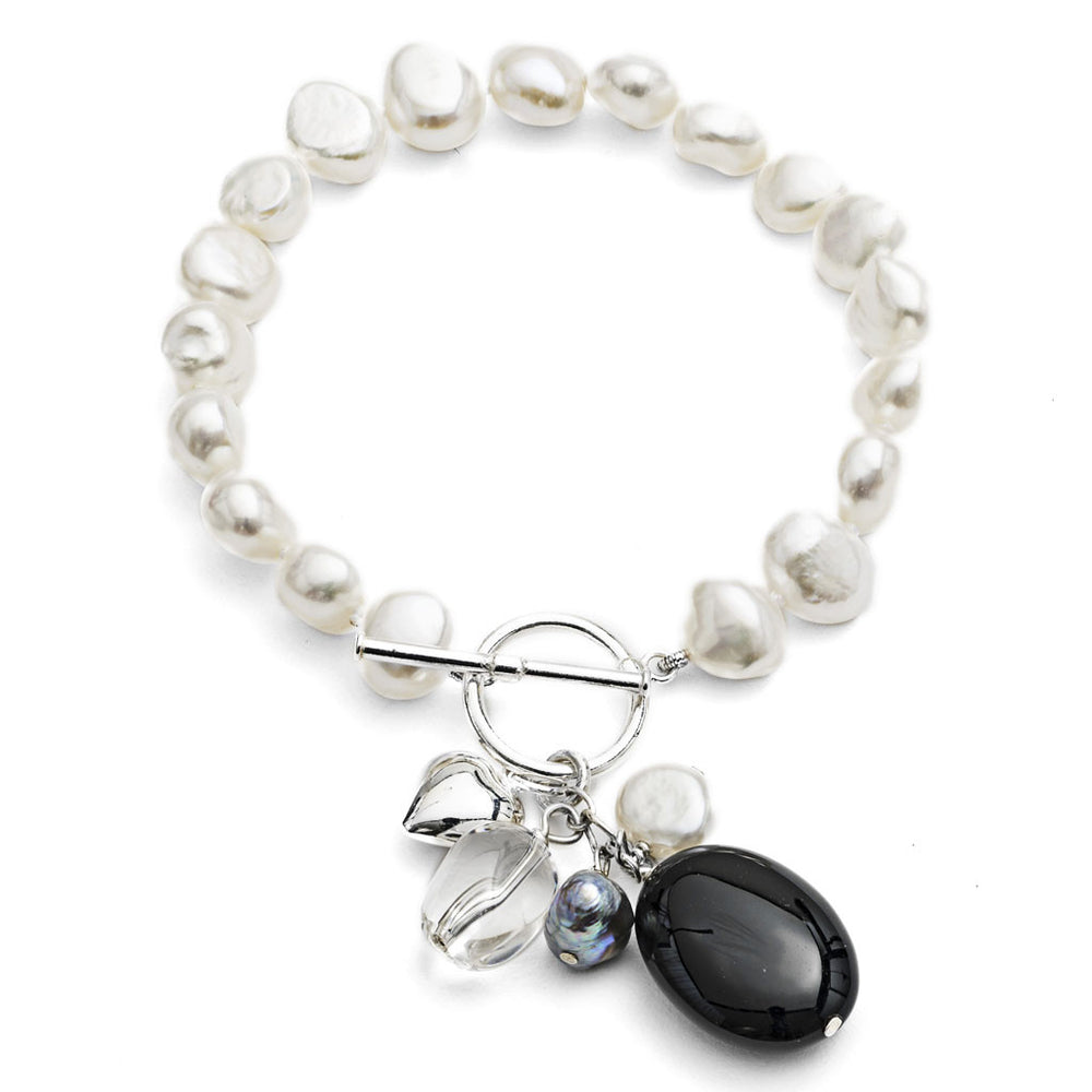 White cultured freshwater pearl bracelet with onyx drop pendant