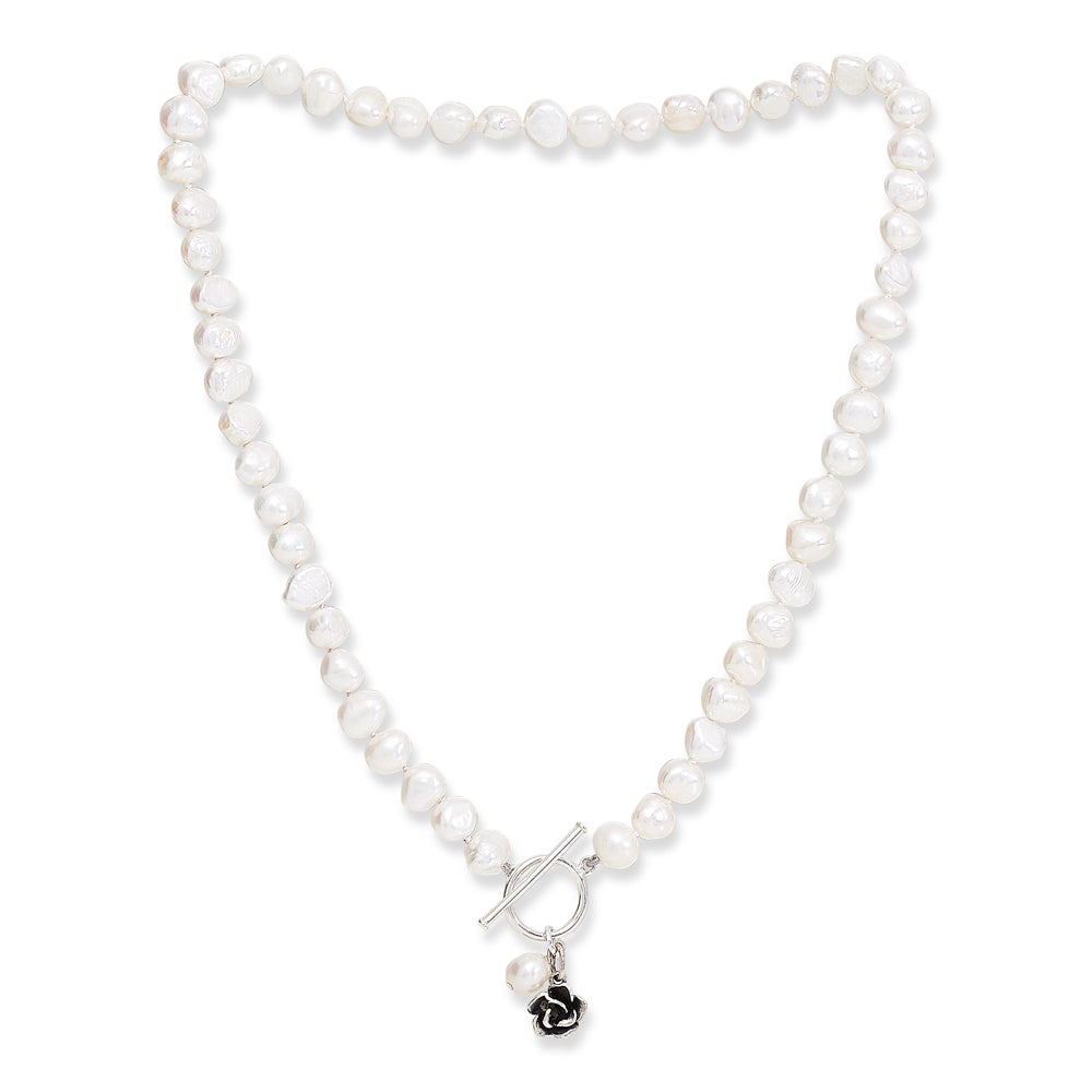 White irregular-shaped cultured freshwater pearl necklace with pearl and flower drop pendant