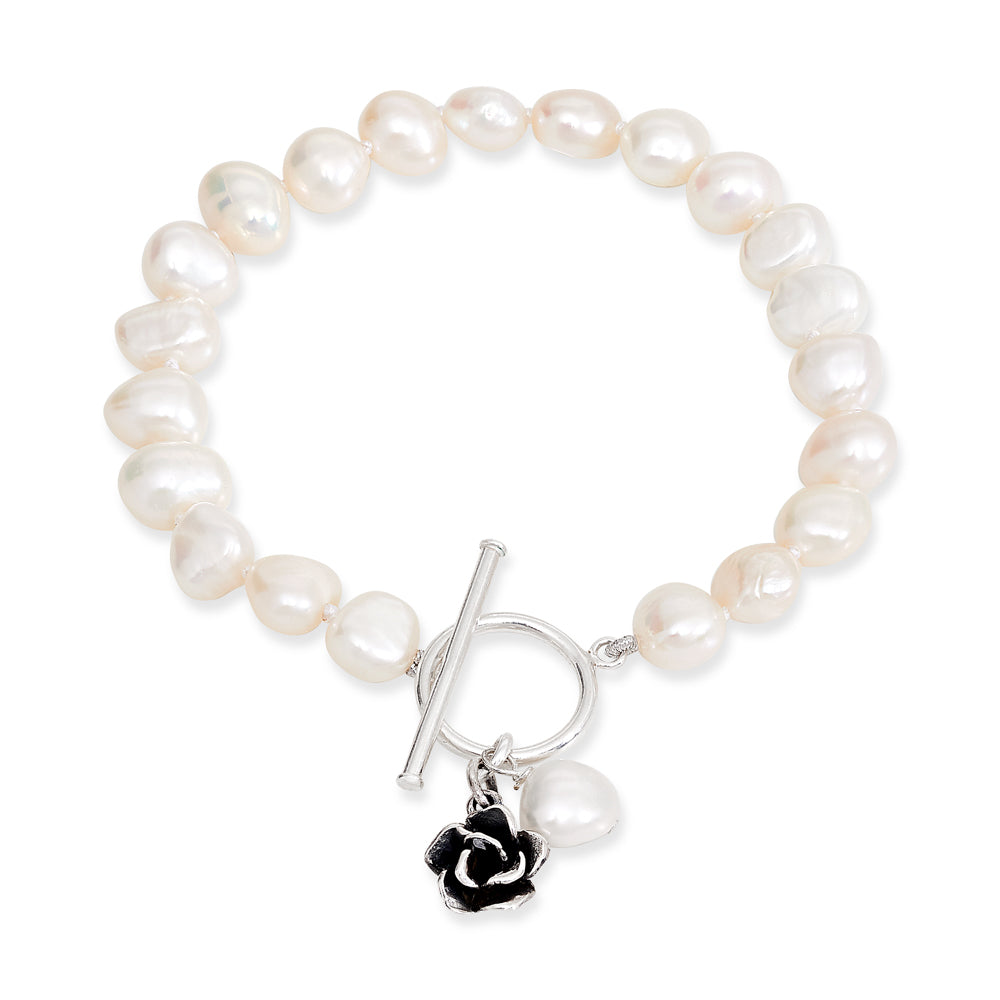 White irregular cultured freshwater pearl bracelet with a pearl and flower drop pendant