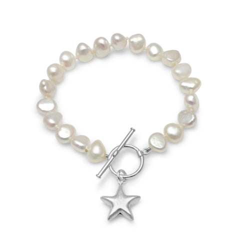 White cultured freshwater pearl bracelet with a sterling silver star charm