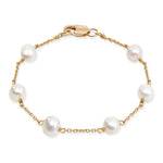 Gold plated sterling silver bracelet with white cultured freshwater pearls