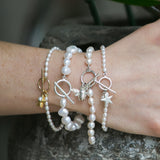Cultured freshwater oval pearl bracelet with a sterling silver star charm