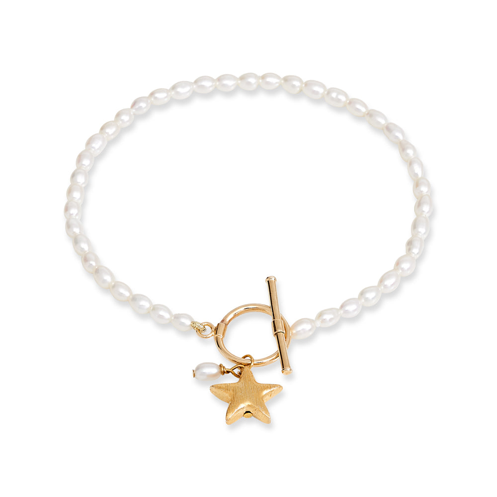 Cultured freshwater oval pearl bracelet with a gold-plated star charm