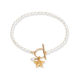 Stella cultured freshwater oval pearl bracelet with a gold-plated star charm