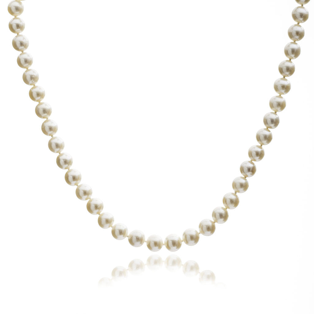 Single strand almost round white freshwater pearl necklace