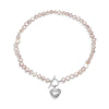 Single strand pink cultured freshwater pearl necklace with silver hammered heart