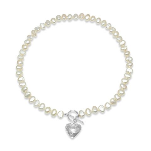 Single strand white irregular cultured freshwater pearl necklace with silver hammered heart