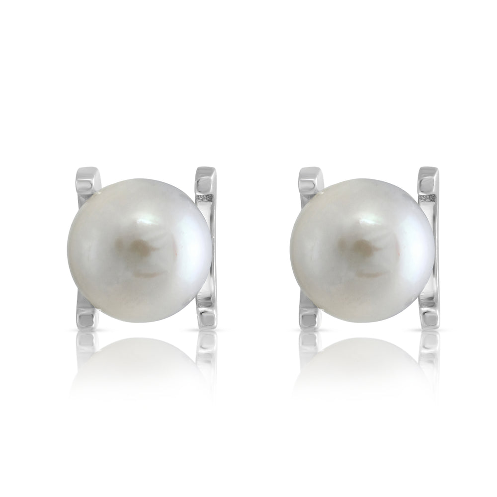 Margarita white cultured freshwater pearl stud earrings in silver claw settings