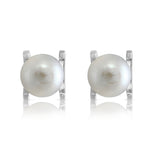 White cultured freshwater pearl stud earrings in silver claw settings